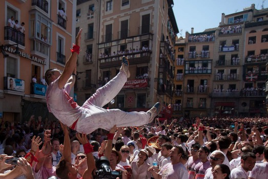 Revellers celebrate during the opening day or 'Chupinazo', of the San Fermin Running of the Bulls fiesta.