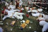 Revelers rest in a park during the first day of the San Fermin Fiestas, in Pamplona