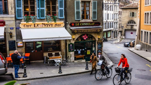 Cyclists and cafe bars at the Vieille Ville (Old Town) Geneva, Switzerland.