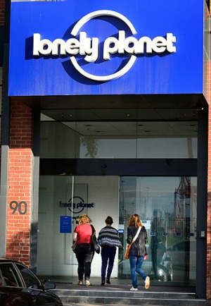 Staff arrive at Lonely Planet's Footscray office on Thursday morning to learn their fate.