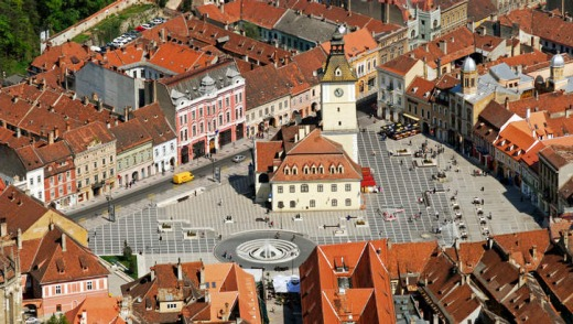 Off the trail: Brasov, with its white church and belfry in the town square.