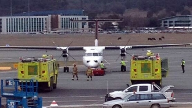 "The Qantas plane is evacuated. <a href=""https://twitter.com/ausandy92/status/361698786805952513/photo/1""> <em>Photo: ..."