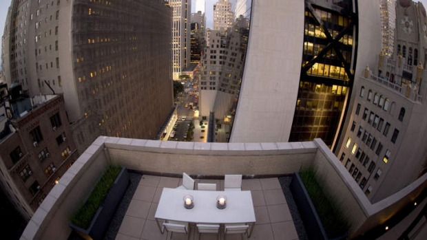 A view of a dining table atop the AKA Central Park Hotel in New York. The room offers a chance to sleep under the stars ...