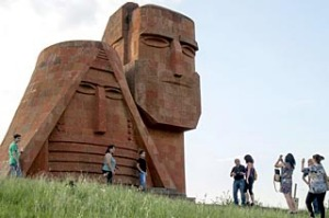 Tourists visit Grandmother and Granfather monument outside city of Stepanakert in Armenian-controlled Azerbaijani region ...