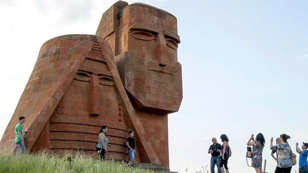 Tourists visit the Grandmother and Granfather monument outside city of Stepanakert in Armenian-controlled Azerbaijani ...