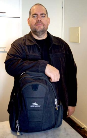 Big man, small bag ... travel writer Tim Richards with his trusty, cabin-size backpack.