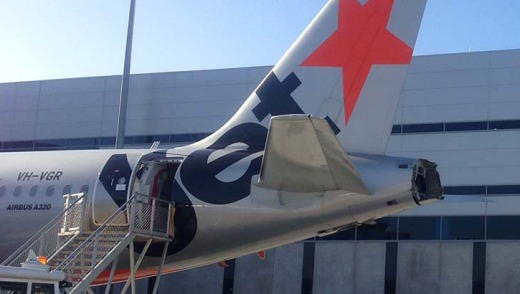 The damaged rear of the Jetstar plane following a collision at Melbourne Airport.