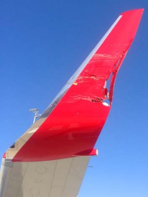 Damage to a Virgin plane after a collision on the tarmac at Melbourne Airport.