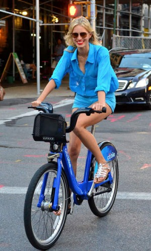 Karolina Kurkova rides a CitiBike on the streets of Manhattan.