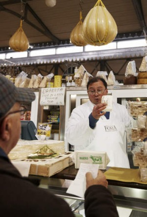 Say cheese: a cheese seller in Modena.