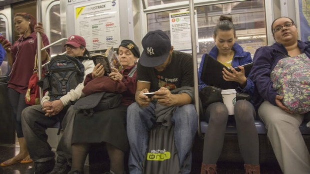 Track work: New Yorkers riding the subway.