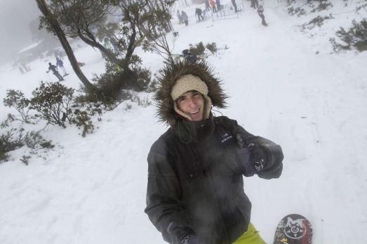 A snow board enthusiast enjoys the snow at Mount Baw Baw's Alpine Resort.