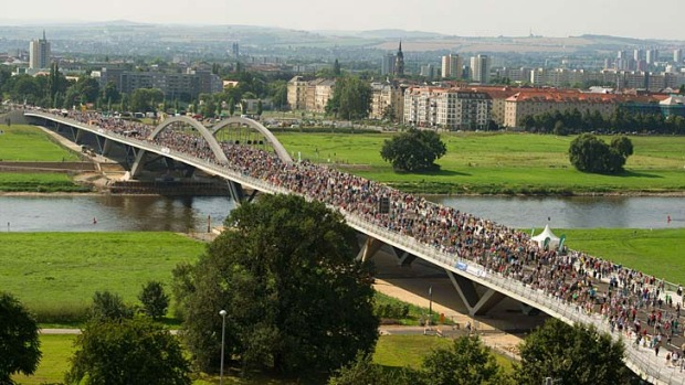 Visitors crowd on the Waldschloesschen bridge spanning over the river Elbe during its inauguration last week in Dresden.