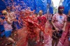 Some 20,000 revellers pelted each other with 130 tonnes of squashed tomatoes in a rain-drenched annual Spanish food ...