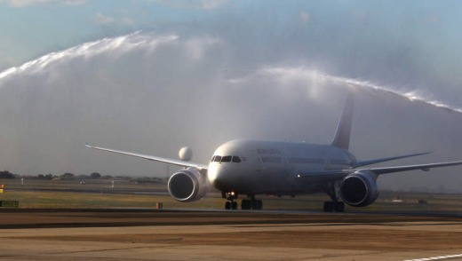 The first Air India Dreamliner flight to Australia is welcomed at Sydney Airport with a water spray.