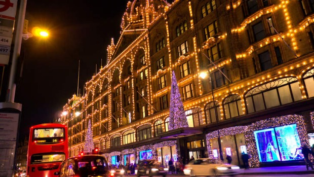 Harrods department store in London is lit up by Christmas lights.