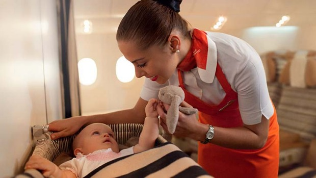 Etihad Airways is training some of its flight attendants to be 'flying nannies' on board flights.