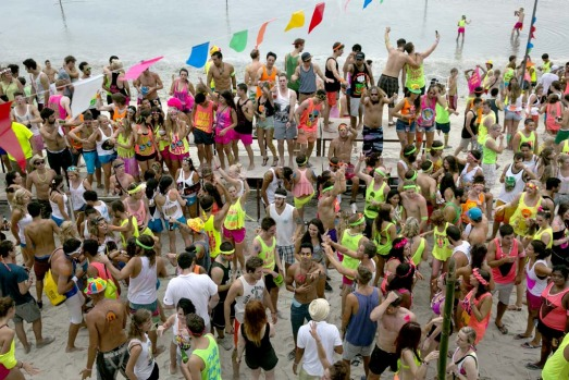 Hundreds of full moon partiers dance on the beach of Haad Rin.
