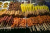 Food stands sell cheap snacks at the full moon party on the beach of Haad Rin.