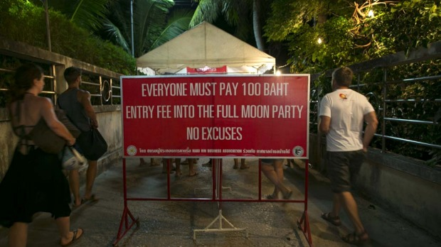 Hundreds of full moon partiers head onto the Haad Rin beach paying 100 Thai bhat ($3.40) for entry.