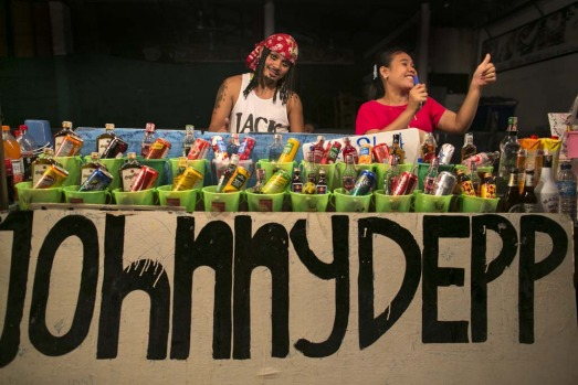 Thai vendors selling cheap liquor on the beach of Haad Rin in Koh Phangan, Thailand.