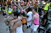 A couple share a warm moment at sunrise at the Full Moon party on Haad Rin beach.