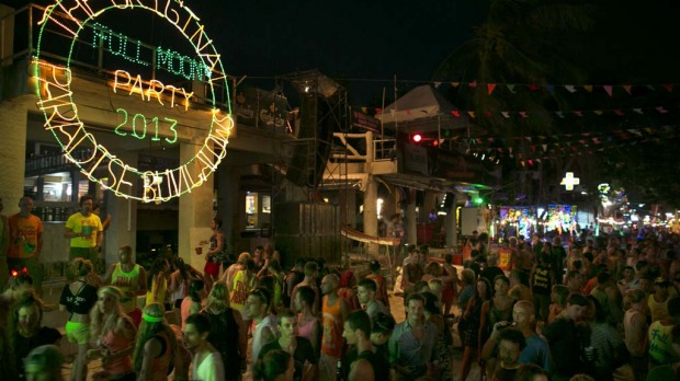 Thousands of people attend the full moon party on the beach of Haad Rin on Koh Phangan, Thailand.