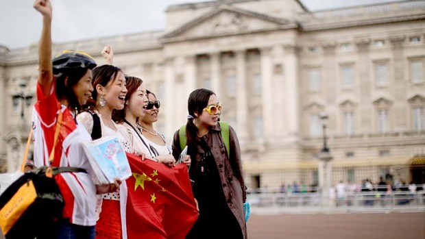 Chinese tourists outside Buckingham Palace in London. Chinese tourist numbers are booming, with Hong Kong, Macau and South Korea the favourite destinations.