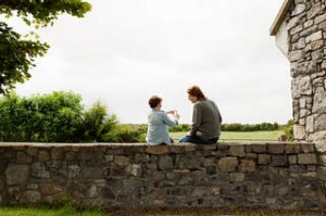 Father and son sitting on stone wall SHD TRAVEL. September 15 - Mama Holiday - Reverse Genealogy: Discover your roots. ...