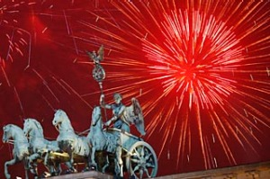 Fireworks light the sky above the Quadriga at the Brandenburg Gate in Berlin shortly after midnight, greeting the New Year