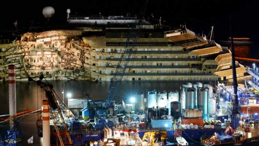 The wreck of Italy's Costa Concordia cruise ship emerges from water near the harbour of Giglio Porto.