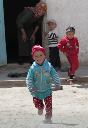Children in the village of Alishur rush out to welcome visitors.