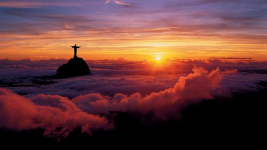 Rio de Janeiro panorama with the Corcovado poking above the clouds.