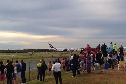 Spectators gather to watch the arrival of the A380.  Photo: Alyshia Gates Nine News via Twitter