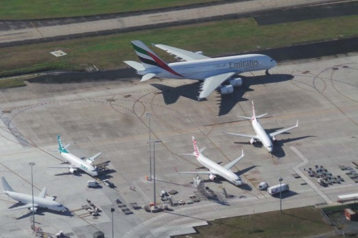 The A380 dwarfs other planes at Brisbane airport. Photo: Penny Dahl/Australian Traffic Network