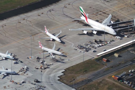 The A380 dwarfs other planes at Brisbane airport. Photo: Penny Dahl