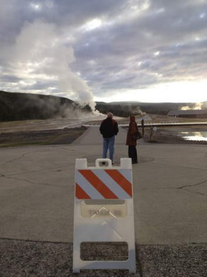 Soft closure: Tourists caught up in the US government shutdown wait for an eruption at the Old Faithful geyser.