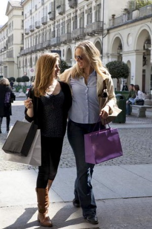 A mother and daughter  shopping in Italy.