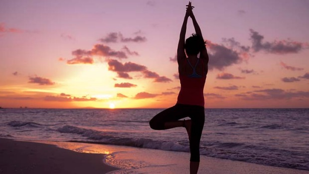 No man's land: Sunset yoga on the beach with Surf Goddess Retreats.