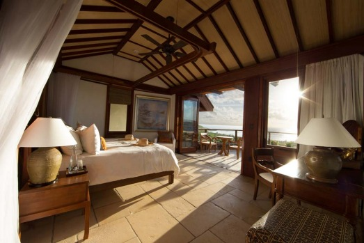There are eight guest rooms with balconies, king-size beds and en suites, and a master suite on the upper level that ...