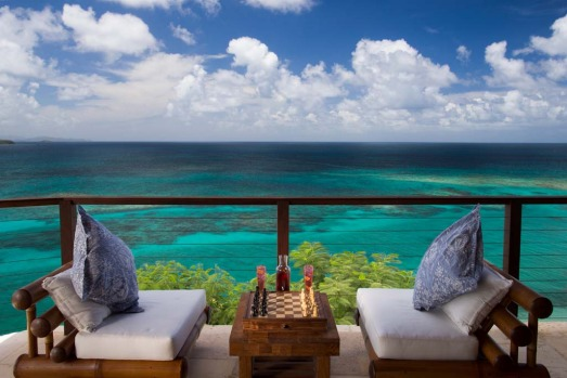The house also features an outdoor terrace with hammocks and sofas, a crow's nest, and a zip-line down to the beach.