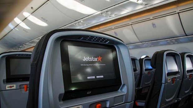 Jetstar's Dreamliner features seatback touchscreens, though economy passengers will need to swipe their credit cards to ...