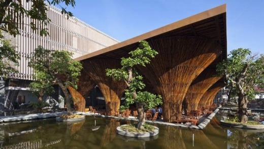 The bamboo columns of the waterside cafe in the Kon Tum Indochine Hotel are inspired by the form of the Vietnamese ...