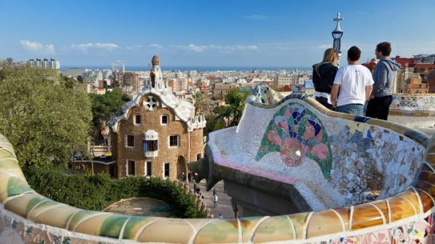 Tourists take in the view in Barcelona, Spain.