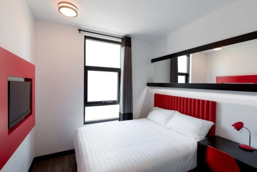 Tune Hotel guests initially pay a minimal room rate and then add on extras such as towels, toiletries, Wi-Fi and ...