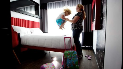 Sarah Keis plays with daughter Charlotte, 3, in their Tune Hotel room.