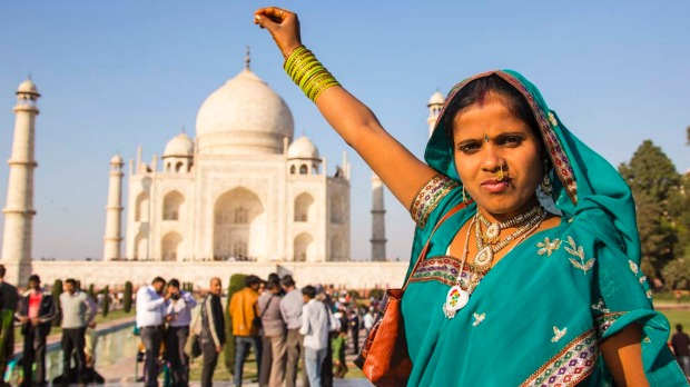 Pinching the top of the Taj Mahal. The sub-continental version of the Leaning Tower shot. Spend any time in the gardens in the front of the Taj and you'll notice a strange phenomenon: lots of people standing around with their arms held horizontally, fingers pinching the air, smiles on their faces. The photographers won't be far away.
