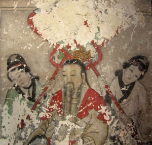 One of the original ancient frescos now covered by cartoon-like paintings in Yunjie Temple in Chaoyang.