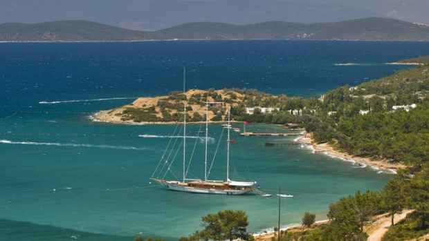 A gulet is  moored in bay in the  Bodrum Peninsula in Turkey.