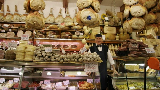 Tradition: A butcher posing in his Bologna deli.